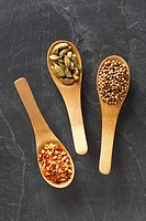 Wooden spoons containing spices
