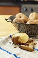 Colander of unpeeled potatoes