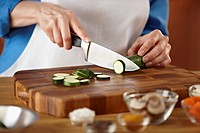 Woman chopping zucchini