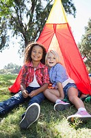 Girls playing in tent (thumbnail)