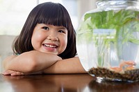 Girl watching pet fish