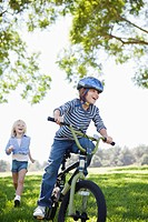 Boy bicycling in park (thumbnail)