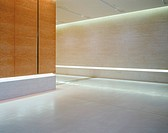 Wood paneled office hallway