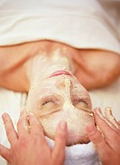 Hands Applying Facial Mask