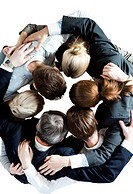 Above view of several business partners embracing each other and making circle