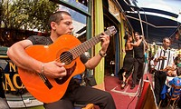 Guitar player and tango dancers at streetside cafe, La Boca, Buenos Aires, Argentina