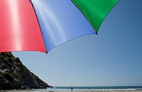 Colorful beach umbrella, Ostriconi beach, Corsica