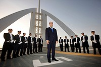 Butlers are lined up on the helicopter pad on the roof of the Burj Al Arab luxury hotel to receive a VIP guest, Dubai, United Arab Emirates, Middle Ea...