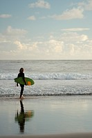 Surfer at the beach of Byron Bay