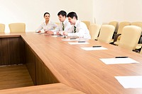 Image of people sitting in the office and discussing business documents