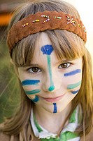 Girl dressed in Native American costume with face painted (thumbnail)