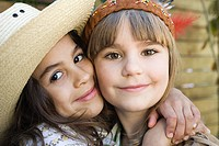 Girls dressed as Native American and cowgirl