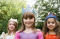 Girls wearing crown dressed up as queens