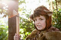 Boy dressed up as bear with toy axe