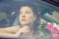 View of beautiful woman sitting in the car driving her to wedding