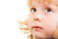 Photo of adorable child with grey eyes looking aside