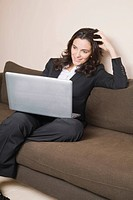 Woman with laptop surfing the internet