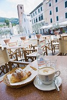 Cappuccino and croissant in the restaurant Gatto Nero, Piazza Carducci, Pietrasanta, Tuscany, Italy, Europe