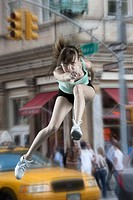 USA, New York City, woman leaping                                                                                                                     ...