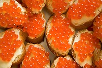 Close_up of delicious sandwiches with red caviar on wedding table