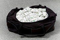 Image of big bag full of American dollars on the floor
