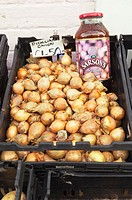 Pickling onions for sale outside a Uk greengrocers shop store