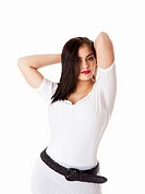 Beautiful brunette Caucasian Hispanic Latina woman with red lipstick standing with hands behind head, wearing white shirt, isolated