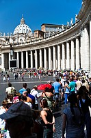 Tourists in St. Peter´s Square in front of St. Peter´s Basilica, Rome, Italy, Europe