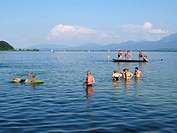 People swimming in the Chiemsee lake, Chiemgau, Upper Bavaria, Bavaria, Germany, Europe