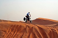 Driving Quad bike in the desert