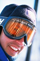 Close up portrait of a young male skier