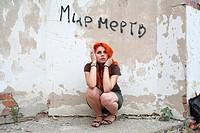 pretty redhead girl against obsolete wall
