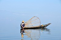 Rowing fisherman with fish trap on boat, Inle Lake, Burma, Myanmar, Southeast Asia