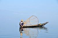 Rowing fisherman with fish trap on boat, Inle Lake, Burma, Myanmar, Southeast Asia