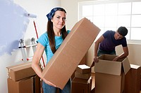 Young couple unpacking on their moving day