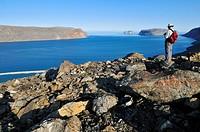 Hiker overlooking Sunshine Fjord, Baffin Island, Nunavut, Canada, Arctic