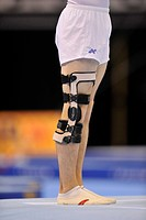 Michal Bolntnar, Czech Republic, performing floor exercises with a leg brace, EnBW Gymnastics World Cup 2009, Porsche_Arena, Stuttgart, Baden_Wuerttem...