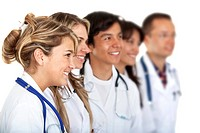 Group of doctors smiling isolated over white
