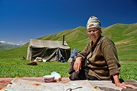 Kyrgyz woman outside a tent drinking horse milk, Kyrgyzstan