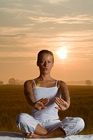 Woman doing Yoga in the Gloaming