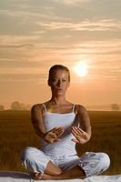 Woman doing Yoga in the Gloaming