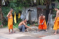Working monks, Trang province, Thailand