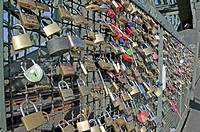 Padlocks as a sign of friendship and love at the metal fence of the Hohenzollernbruecke Hohenzollern Bridge in Cologne, North Rhine-Westphalia, German...