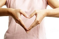 A woman´s hands forming a heart symbol
