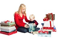 A caucasian mother and son opening christmas gifts