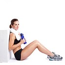 An isolated shot of a beautiful caucasian woman sitting after exercise