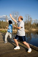 A shot of a senior asian couple practicing taichi exercise