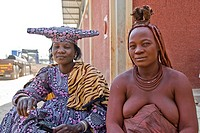 Himba and Hererowomen in a village near Epupa Falls, Namibia, Africa