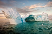 Iceberg with tunnel at sunset, Cierva Cove, Antarctic Peninsula.