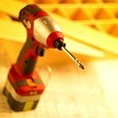 construction, an electric drill on a desk